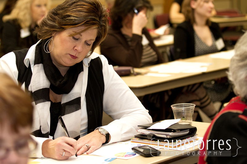 Attendee takes notes during workshops